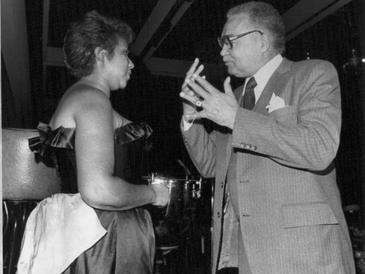 Aretha Franklin and Mayor Young talk at a benefit for