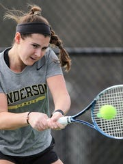 Laura Dean returns a ball during practice at the Anderson University Sports Complex tennis courts.