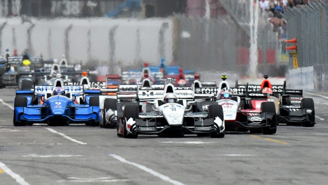 Jul 16, 2017; Toronto, Ontario, CAN; Pole sitter Simon Pagenaud (1) leads the Verizon IndyCar series field on the opening lap during the Honda Indy Toronto at Streets of Toronto.