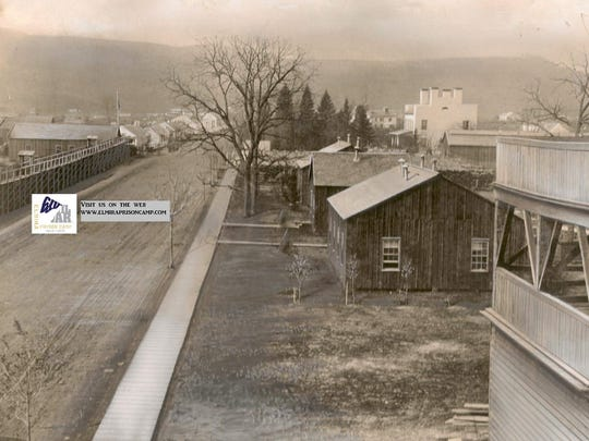 This photo from the 1860s shows the Elmira Civil War prison camp on the left side of Water Street. The large white building in the upper right is the Foster House.