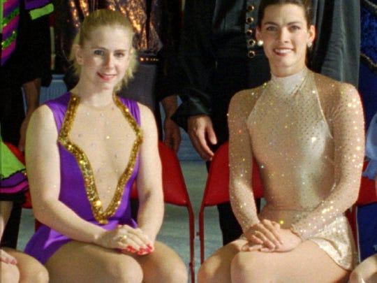 U.S. figure skaters Tonya Harding (left) and Nancy Kerrigan  pose at the U.S. Figure Skating Championships in 1994.
