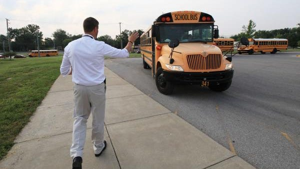 West Clark Superintendent Chad Schenck greets buses outside of Silver Creek Elementary School on Wednesday morning on the first day of classes in the district.July 29, 2015