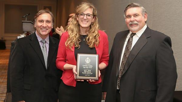 Page High School teacher Caroline Hadley, middle, has been named a region-level Teacher of the Year finalist.
