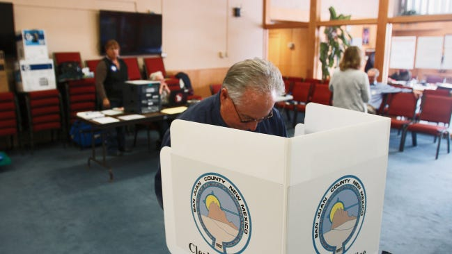 Flint Mobley votes in the San Juan College board election Tuesday at Farmington City Hall.