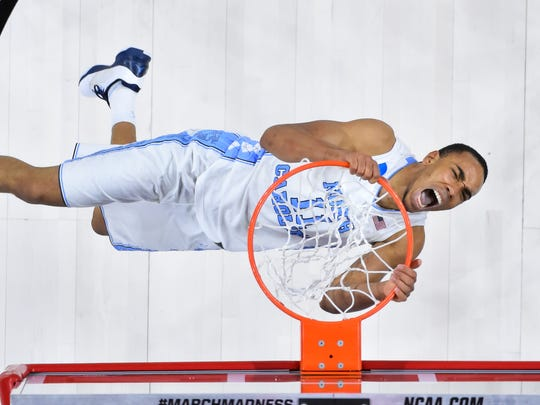North Carolina forward Brice Johnson dunks the ball against the Providence Friars during the second round of the 2016 NCAA Tournament at PNC Arena.