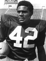 "University of Michigan football star #42 William ""Billy"" Taylor in 1975."
