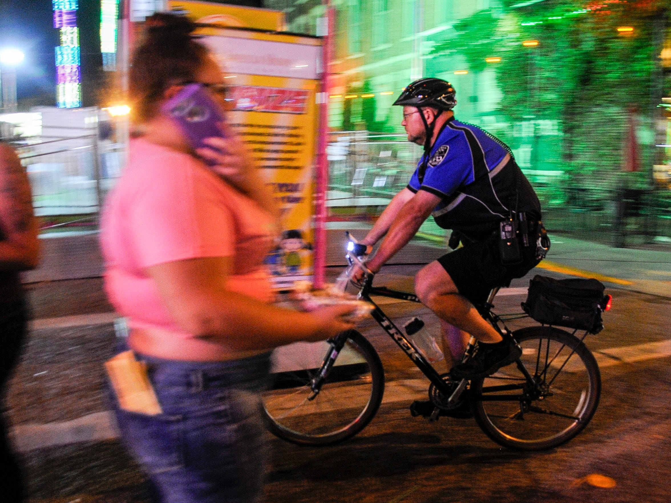 An EPD officer on bike patrol rides into the game  area after closing during  the 2017 WSNC Fall Festival.