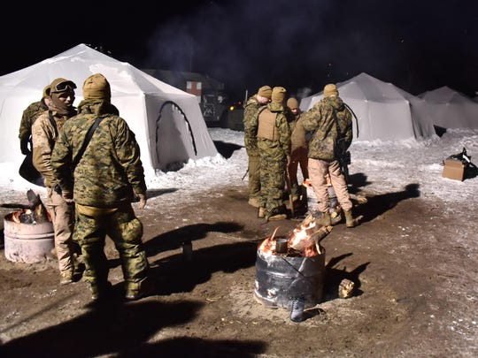 U.S.Marine Corp reservists relax after a day of training. The leathernecks are spending two weeks in the snow and cold during the training, living in huge tents.