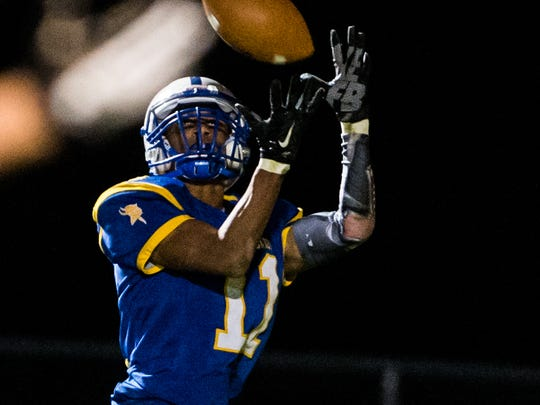 Northern Lebanon's Christian Trader hauls in a touchdown pass as Northern Lebanon defeated Elco 49-20 on Friday night.