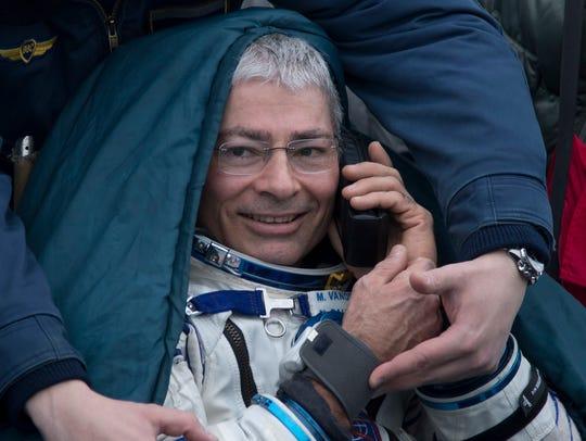 NASA astronaut Mark Vande Hei rests in a chair.