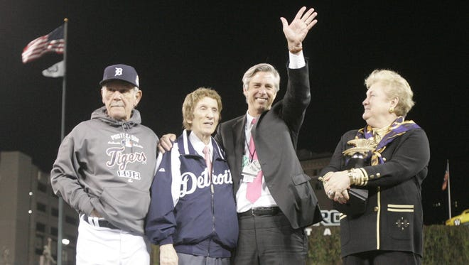 Jim Leyland, Mike Ilitch, Dave Dombrowski and the AL honorary president Jackie Autry on the stage after  the Tigers won Game 4 of the ALCS between the Tigers and the Yankees in 2012.