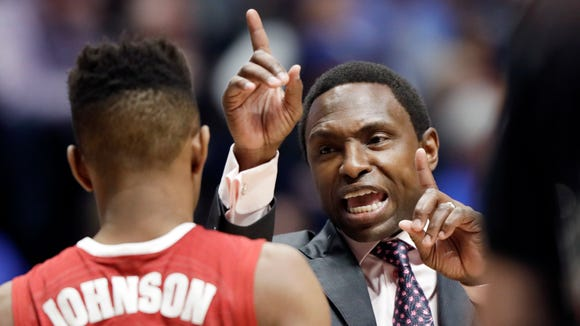 Alabama head coach Avery Johnson talks to guard Avery Johnson Jr. (5) in the first half of an NCAA college basketball game against Kentucky in the semifinals of the Southeastern Conference tournament Saturday, March 11, 2017, in Nashville, Tenn. (AP Photo/Wade Payne)