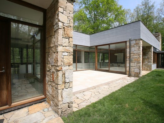 The exterior of this 1999 built modern home on Colonel Sheldon Lane in Pound Ridge, May 14, 2014.