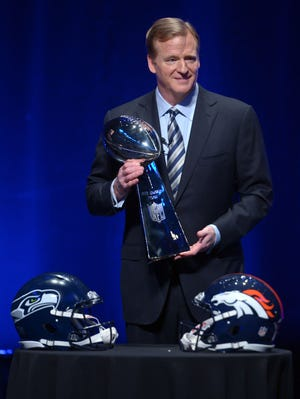 NFL Commissioner Roger Goodell holds the Vince Lombardi Trophy at Rose Theater in advance of Super Bowl XLVIII. He held his state of the league address Friday.