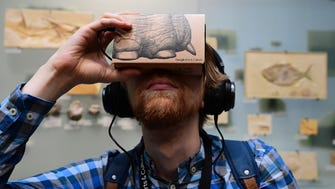 "A journalist uses a smartphone equipped with a so-called ""Google Cardboard"" mount to use it as a VR (virtual reality) device for trying out a new offer developed by Google's platform ""Google Arts & Culture"" and the Museum of Natural History in Berlin, Germany."