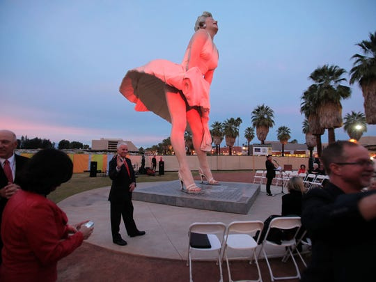 "Red lights flood the ""Forever Marilyn"" statue in downtown Palm Springs in January 2014."