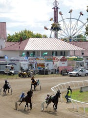 Horses round the track at the Fairfield County Fair.