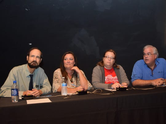 Members of The Town Talk quiz bowl team listen to a question Tuesday during the Corporate Quiz Bowl Alexandria. From left are Richard Sharkey, Shelly Leger, Melissa Gregory and Jim Smilie. The Town Talk team won its two rounds of competition and advanced to the semifinals.
