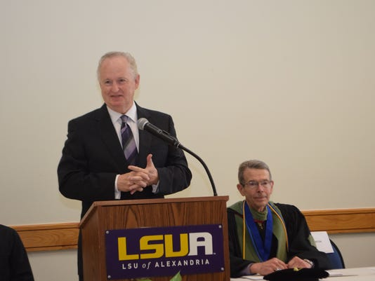 ANI LSUA ConvocationJim Clinton (left), president and CEO of CLEDA, speaks a the second annual new stunt convocation held Wednesday at LSUA. Dan Howard (right), chancellor of LSUA, introduced Clinton.-Melinda Martinez/The Town Talk