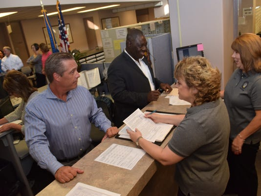 ANI QualifyingChris Tyler (lower left) qualifies to run for Louisiana state representative of District 27 while Joshua Joy Dara (upper,left) qualifies to run as Louisiana state senator of the 29th senatorial district Tuesday, Sept. 8, 2015 at the Rapides