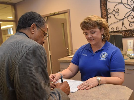 Rapides Parish Clerk of Court Robin Hooter (right)
