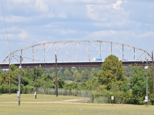 The iconic steel superstructure of the O.K. Allen Bridge can be seen behind the Curtis-Coleman Memorial Bridge over the Red River. Weather permitting, demolition of the O.K. Allen Bridge is scheduled to take place Saturday morning.