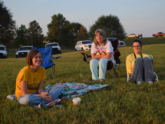 Amanda Carroll (left) arrived on the Red River levee  in Alexandria at 6:30 a.m. Saturday to get a spot from which to watch the demolition of the O.K. Allen Bridge. With her are Brigitte Juneau (center) and Stephanie Charrier.