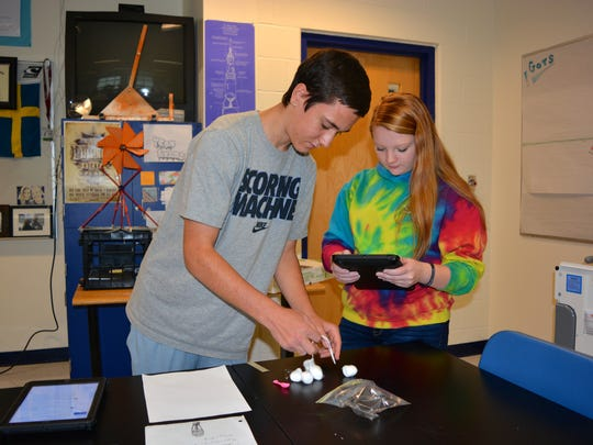 Noah Conner and Kelsey Shafer use iPads in Jeff Kilner's physics class at Sussex Central High School.