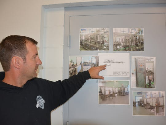 Aric Schmilling shows the plans for the Ahnapee Brewery