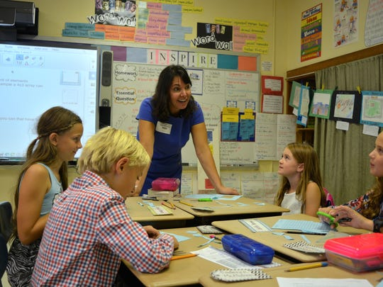 Kathy McGuiness, a Rehoboth Beach city commissioner and candidate for Delaware Lieutenant Governor, was principal for the day at Rehoboth Elementary School. McGuiness observes Renee Kosc's Cape Accelerated Program class at the school.
