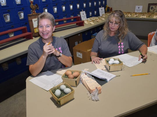 Emily Winners (left) and Liz Pace tag eggs for judging in the 4-H Show at the Rapides Parish Fair.