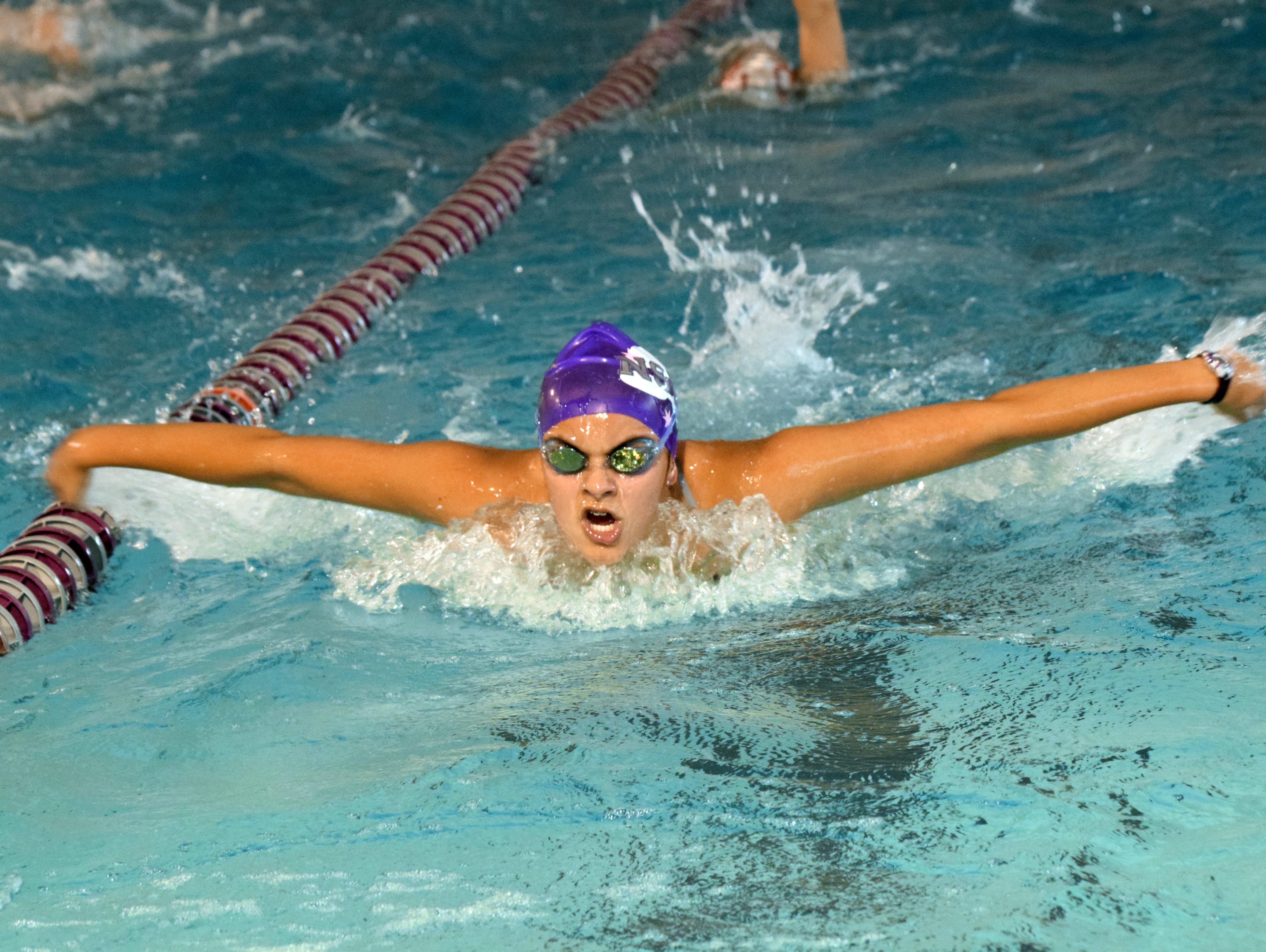 ASH's Brianna Serret swims butterfly at swim practice Thursday at the ASH swimming pool.
