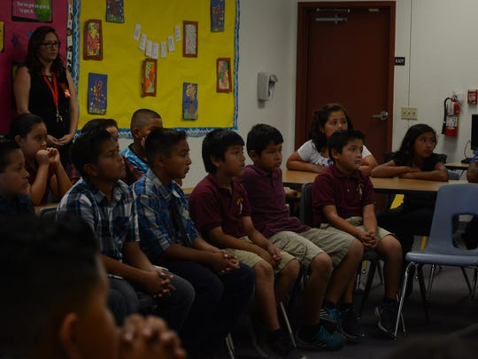 Students at Valley View Elementary School in Indio listen to a presentation by the District Attorney's Office about gang violence for Red Ribbon Week.