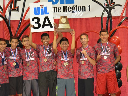 The Tornillo cross country team celebrates its back-to-back Region 1-3A championship.