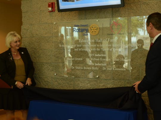 CSUSB Palm Desert Dean Sharon Brown-Welty and College of the Desert President Joel Kinnamon unveil the Palm Desert Rotary Club Hall of Fame plaque.