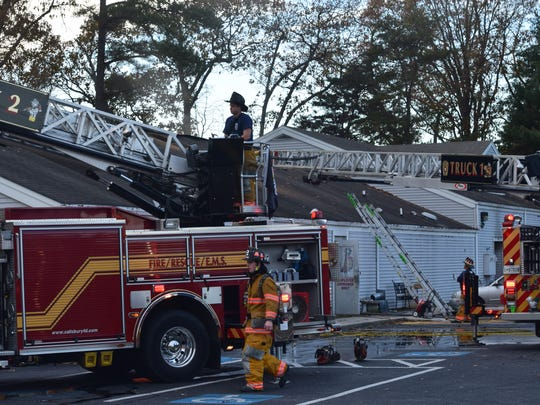 Firefighters mops up after a blaze Nov. 8 at Robinson's Family of Businesses in Salisbury on South Salisbury Boulevard.