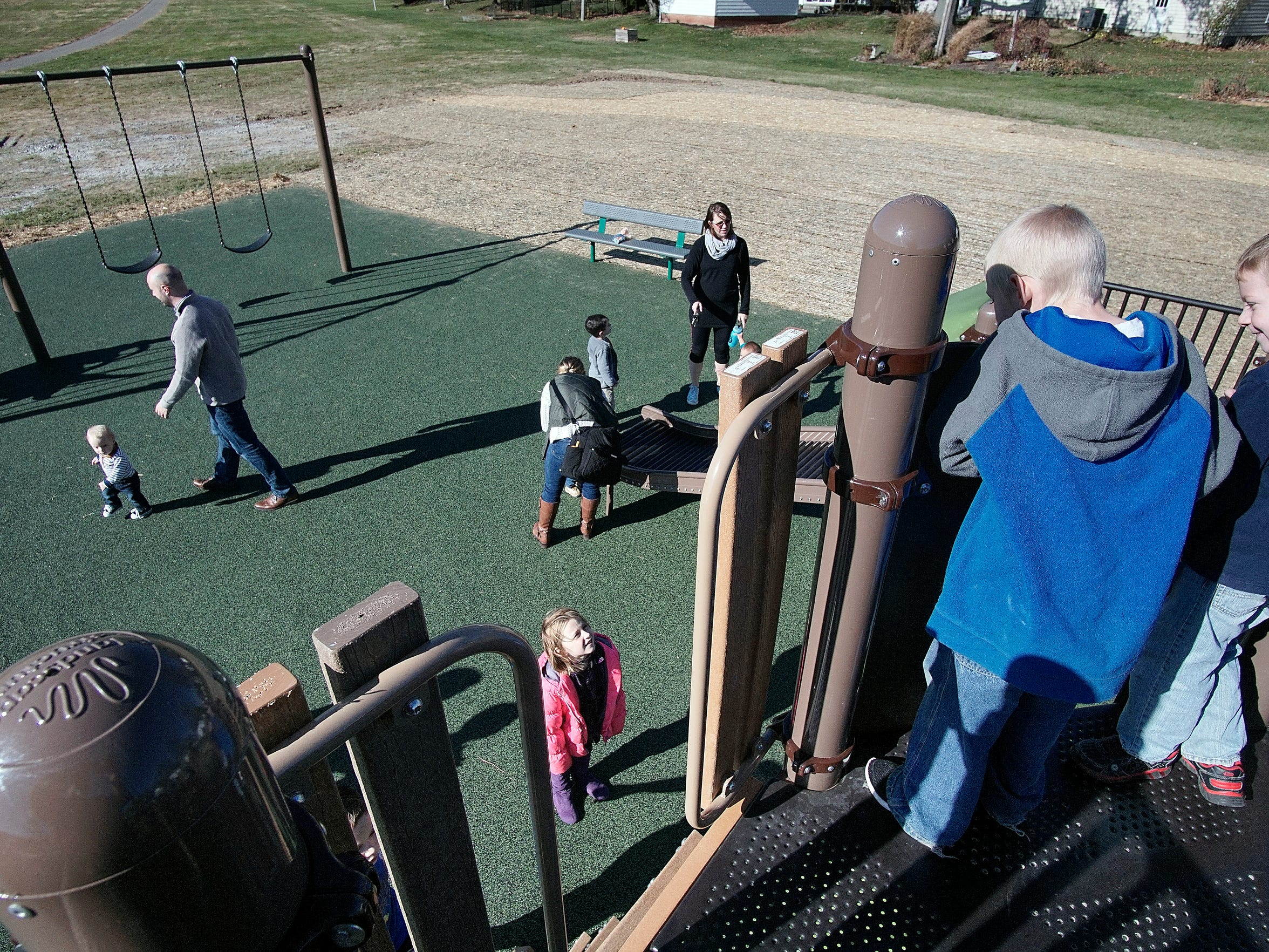 Kids play Sunday morning in a new playground designed to be inclusive for kids with developmental disabilities.
