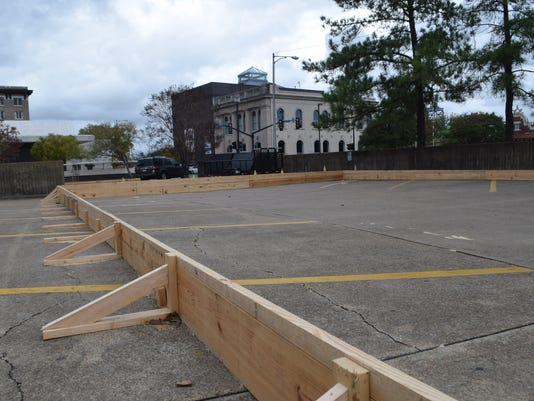 An ice skating rink is being built in the parking lot near Alexander Fulton Mini-Park in downtown Alexandria.