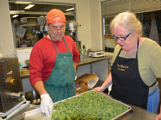 Mario Micheli and Mary Pat Carlson examine some of the kale and pepper pasta Micheli is making under his Clario Farmstead Pasta label.