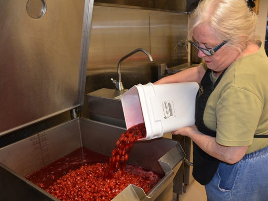 Mary Pat Carlson prepares to make her Door County Wildwood Market cherry salsa at the Algoma Farm Market Kitchen she founded 16 years ago.