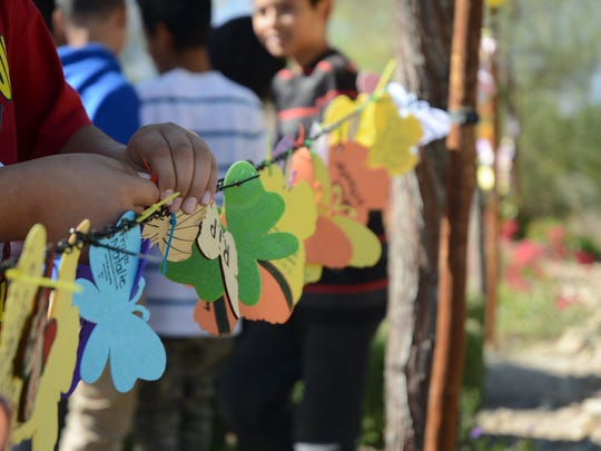 Students from Peter Pendleton Elementary School learned about the terrorist attack victims in Paris and created butterflies for them. Each butterfly at the Tolerance Education Center represents the victim of a hate crime.