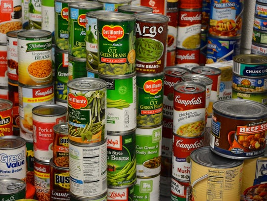 Cans of food overflow the Knights Pantry at Sussex