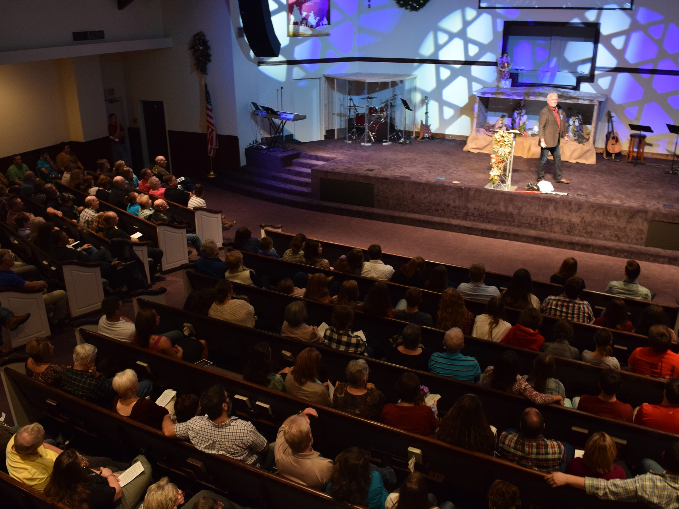 Pastor James Greer leads Journey Church members in worship Sunday. The church has grown from seven members when it was Lee Heights Family Church to more than 1,000.