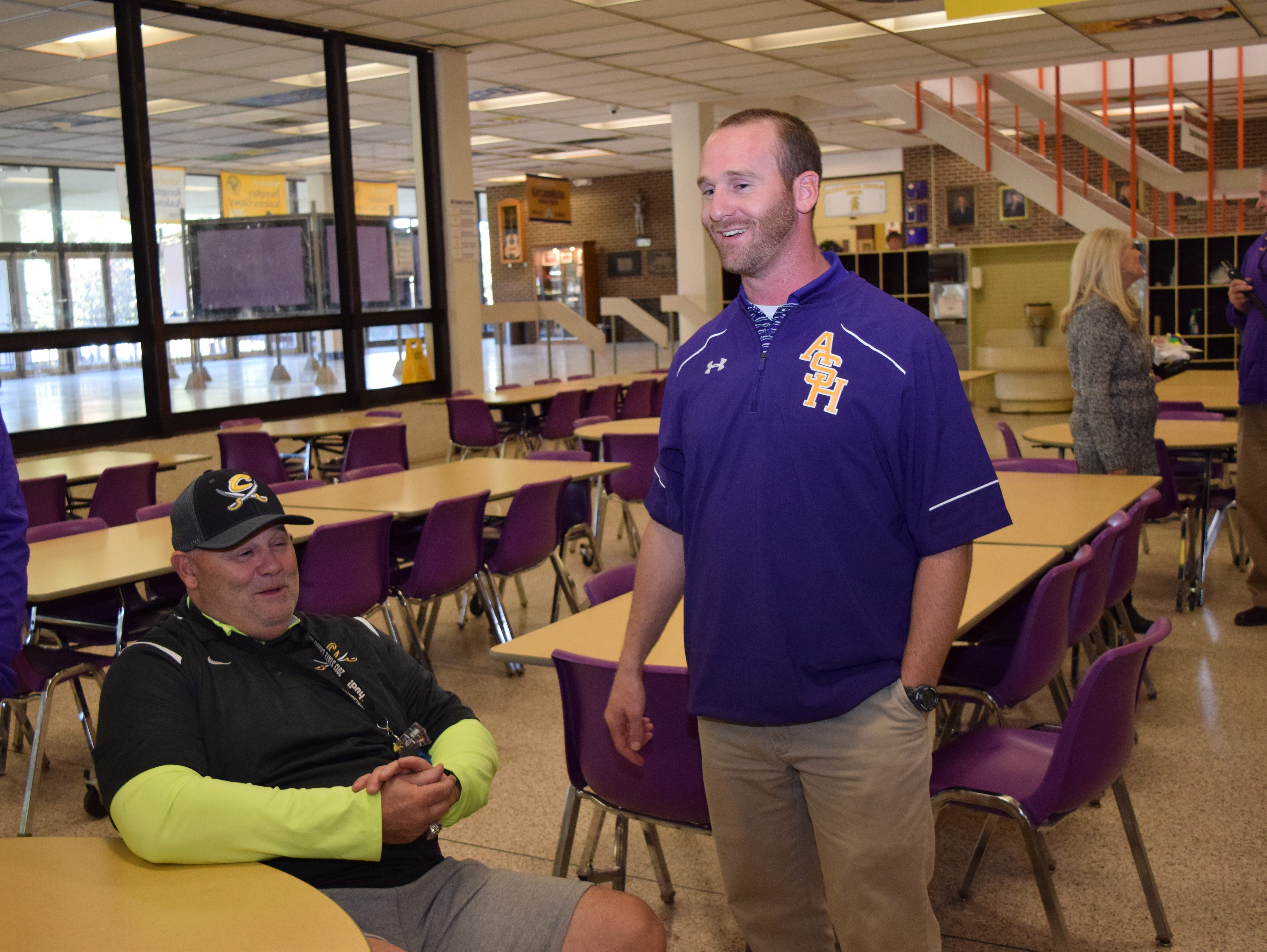Thomas Bachman (right) was named head football coach at Alexandria Senior High School Friday. With him is his father John Bachman Sr., who is also a football coach.