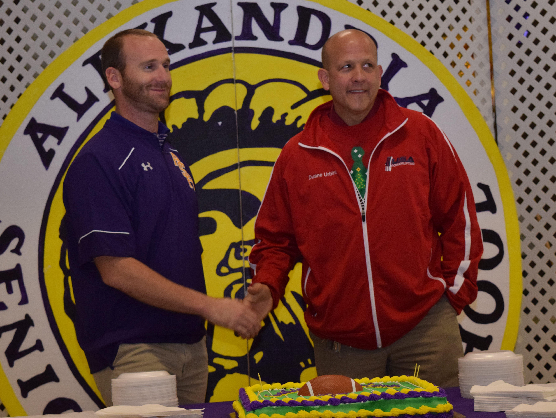 Thomas Bachman (left) was named head football coach at Alexandria Senior High School by principal Duane Urbina Friday.