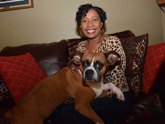 Janet Dixon holds her dog, Laila Ali, at her Alexandria