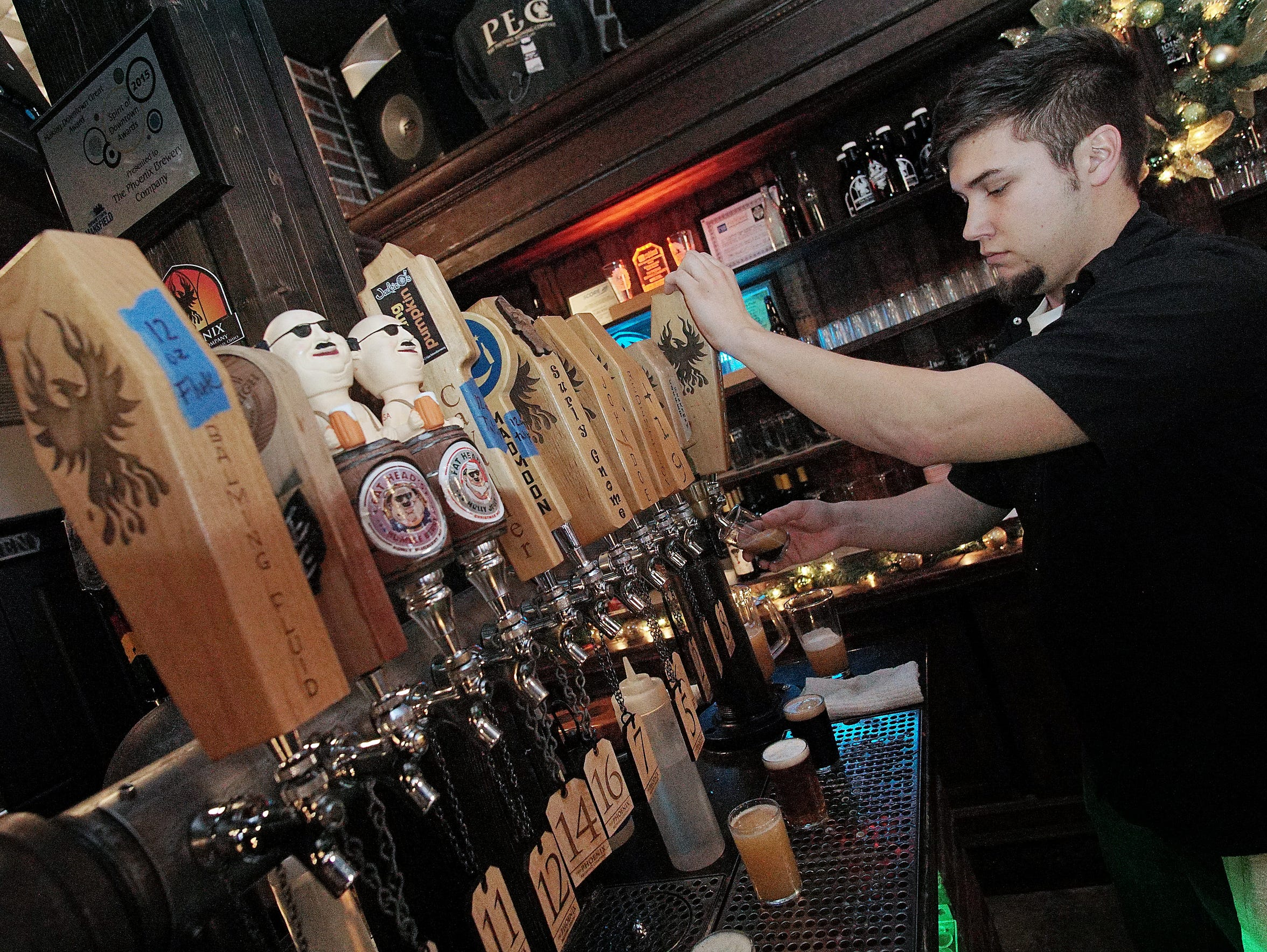 Ian Cardwell pours some beer at the Phoenix Brewing