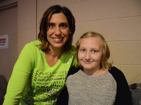 Amy Shaw with her daughter Maddie Shaw, then 11, at the 2015 Holiday Jam to raise money to help Maddie in her battle against Ewing sarcoma, a rare bone cancer.