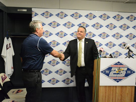 Binghamton Mayor Richard David, right, shakes hands with new Binghamton Mets owner John Hughes at a press conference Monday.