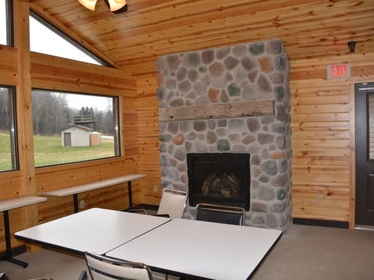 The addition to Winter Park's chalet features a gas fireplace and expansive views of the hills.